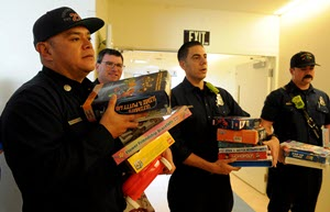 Firefighters delivering toys