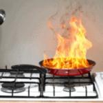 Fire in a pan on a stove